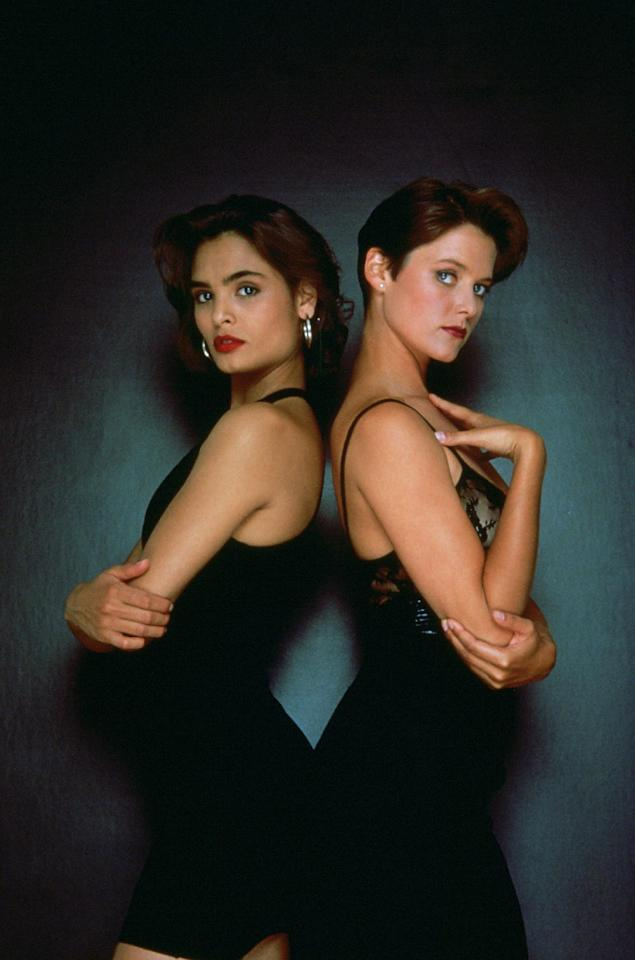 """This undated publicity photo provided by United Artists and Danjaq, LLC shows Talisa Soto, left, and Carey Lowell in the James Bond 1989 film, """"Licence to Kill."""" Always glamorous and sophisticated, yet uniquely susceptible to James Bond's flirtations, the Bond girl over the years has become as compelling as Agent 007 himself, and not just for the way she fills out a swimsuit. The film is included in the MGM and 20th Century Fox Home Entertainment Blu-Ray """"Bond 50"""" anniversary set. (AP Photo/United Artists and Danjaq, LLC)"""