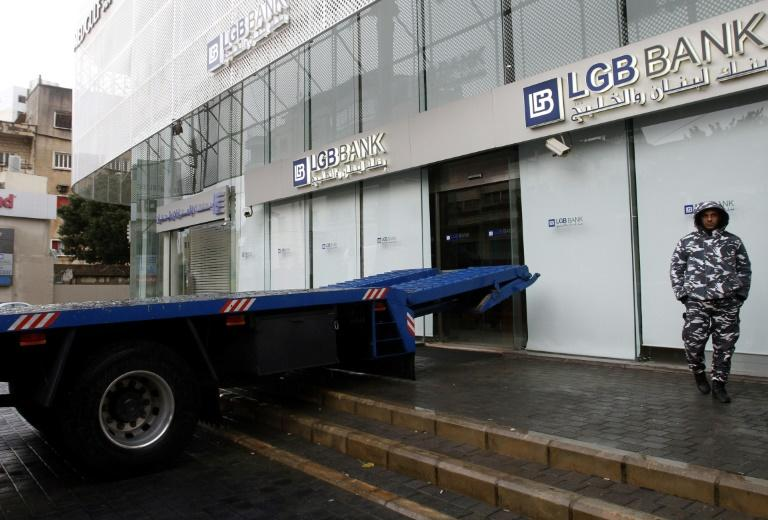 A flatbed truck, placed by an angry Lebanese client, blocks the entrance to his bank branch in the southern city of Sidon