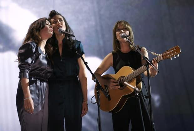 Feist, right, performs a tribute to Leonard Cohen at the Juno Awards on April 2, 2017, in Ottawa.