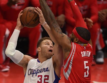 At least Blake Griffin will only have to deal with Josh Smith during practice this season. (AFP Photo)