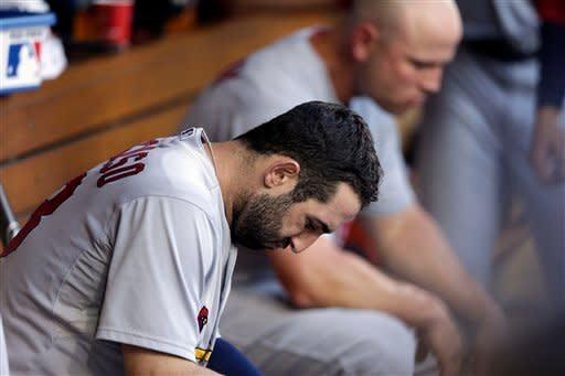 St. Louis Cardinals second baseman Daniel Descalso, front, looks down during the ninth inning of their baseball game against the San Diego Padres, Wednesday, Sept. 12, 2012, in San Diego. The Cardinals lost to the Padres 3-2. (AP Photo/Gregory Bull)