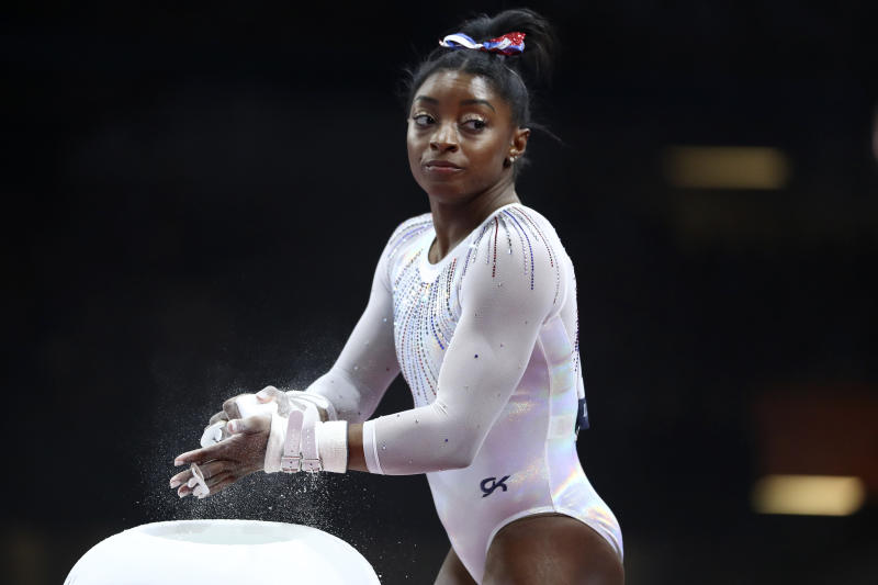 Simone Biles of the United States gets ready to perform on the uneven bars in the women's all-around final at the Gymnastics World Championships in Stuttgart, Germany, Thursday, Oct. 10, 2019. (AP Photo/Matthias Schrader)