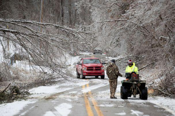 PHOTO: Vehicles navigate through downed trees along Blue Sulpher Road, Feb. 16, 2021, in Ona, West Virginia. (Sholten Singer/The Herald-Dispatch via AP)