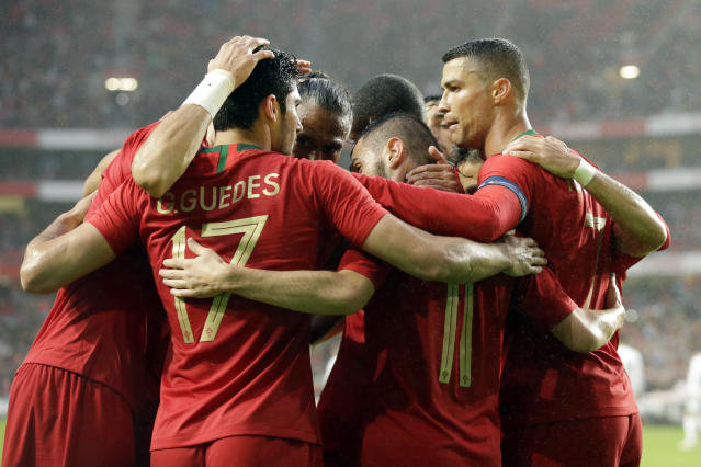 Portugal's Goncalo Guedes, 2nd from left, Bernardo Silva, 2nd from right and Cristiano Ronaldo, right, celebrate the opening goal during a friendly soccer match between Portugal and Algeria in Lisbon, Portugal, Thursday, June 7, 2018. (AP Photo/Armando Franca)