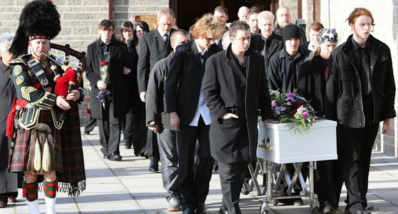 Mourners with Sophie Lancaster's coffin at her funeral.