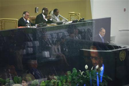 Russia's Minister of Foreign Affairs Sergey Lavrov (R) is reflected on a screen as he speaks during the 68th session of the United Nations General Assembly at the U.N. headquarters in New York September 27, 2013. REUTERS/Shannon Stapleton