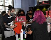 """<p>Nico Ali-Walsh, Amira Ali, and Nadia Ali, all of Nevada, get snacks before seeing the movie """"Star Wars: Episode V - The Empire Strikes Back"""" at AMC Town Square 18 on August 20 in Las Vegas, Nevada.</p>"""