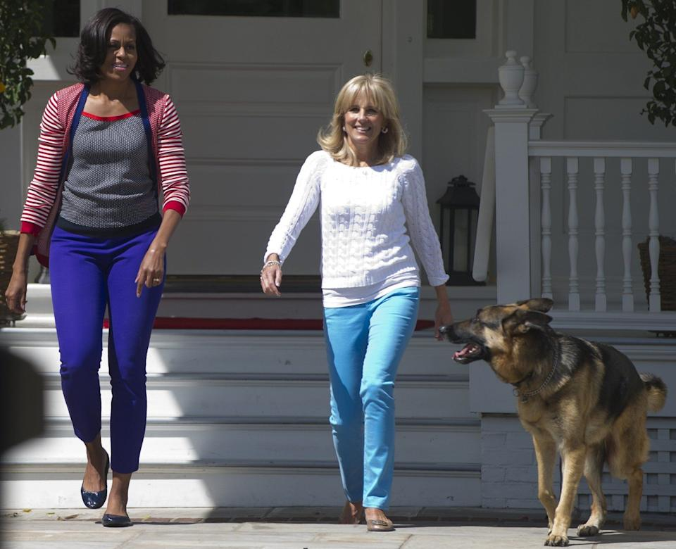 Michelle Obama, Jill Biden and Champ arrive to help assemble Mother's Day packages that deployed U.S. troops requested to be sent to their mothers and wives at home at the Naval Observatory in May 2012. (Photo: SAUL LOEB via Getty Images)