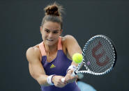 Greece's Maria Sakkari makes a backhand return to Japan's Nao Hibino during their second round singles match at the Australian Open tennis championship in Melbourne, Australia, Wednesday, Jan. 22, 2020. (AP Photo/Andy Wong)