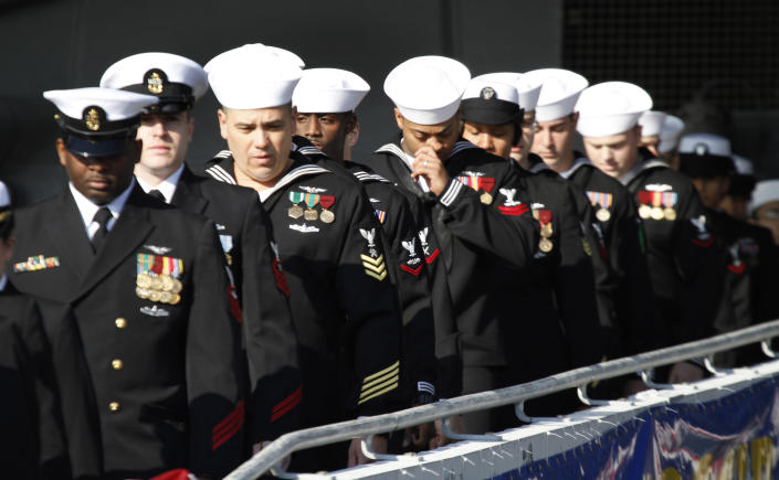 The crew of the first nuclear powered aircraft carrier USS Enterprise disembark during the inactivation ceremony at Naval Station Norfolk Saturday, Dec. 1, 2012 in Norfolk, Va. The ship served in the fleet for 51 years. (AP Photo/Steve Helber)