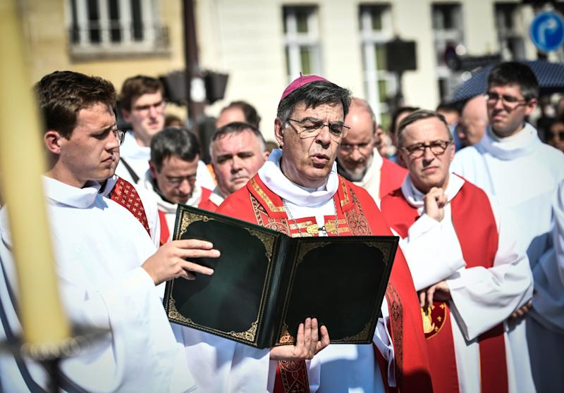 Paris Archbishop Michel Aupetit leads Holy Week celebrations near Notre Dame Cathedral on April 19, 2019, four days after a fire engulfed the 850-year-old Gothic masterpiece. (STEPHANE DE SAKUTIN via Getty Images)