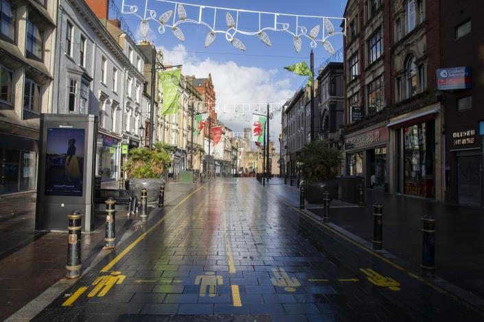 CARDIFF, WALES, UNITED KINGDOM - OCTOBER 30, 2020 - The empty high street of Cardiff City centre at the start of the second week of the two-week firebreak lockdown to slow the spread of coronavirus. The First Minister has announced that at the end of the lockdown on November 9th, two families will be allowed to form a bubble and there will be no travel restrictions within Wales. - PHOTOGRAPH BY Mark Hawkins / Barcroft Studios / Future Publishing (Photo credit should read Mark Hawkins/Barcroft Media via Getty Images)