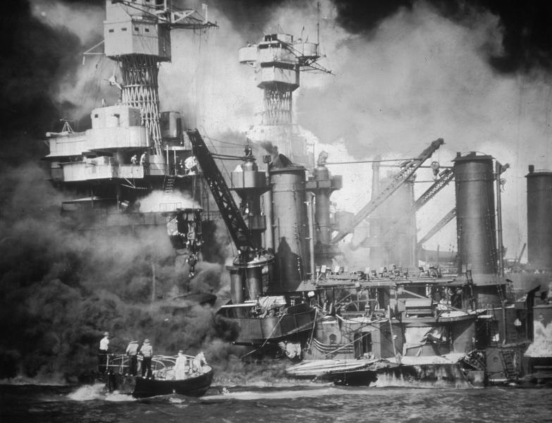 FILE - In this Dec. 7, 1941 photo provided by the U.S. Navy, sailors on a small boat rescue a USS West Virginia crew member from the water after the Japanese attack on Pearl Harbor, Hawaii. (AP Photo/U.S. Navy)