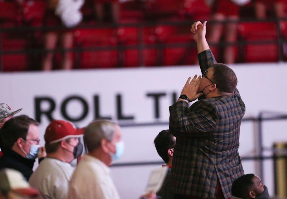 Luke Ratliff leads the cheers in the student seating area as the Crimson Tide hosts Vandy on Feb. 20 in Coleman Coliseum in Tuscaloosa, Ala.