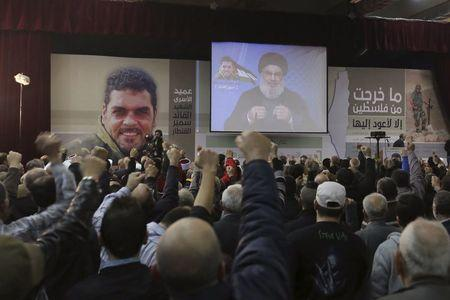 Lebanon's Hezbollah leader Sayyed Hassan Nasrallah addresses his supporters via a screen during a commemoration service marking one week since the killing of Hezbollah militant leader Samir Qantar, in Beirut's southern suburbs
