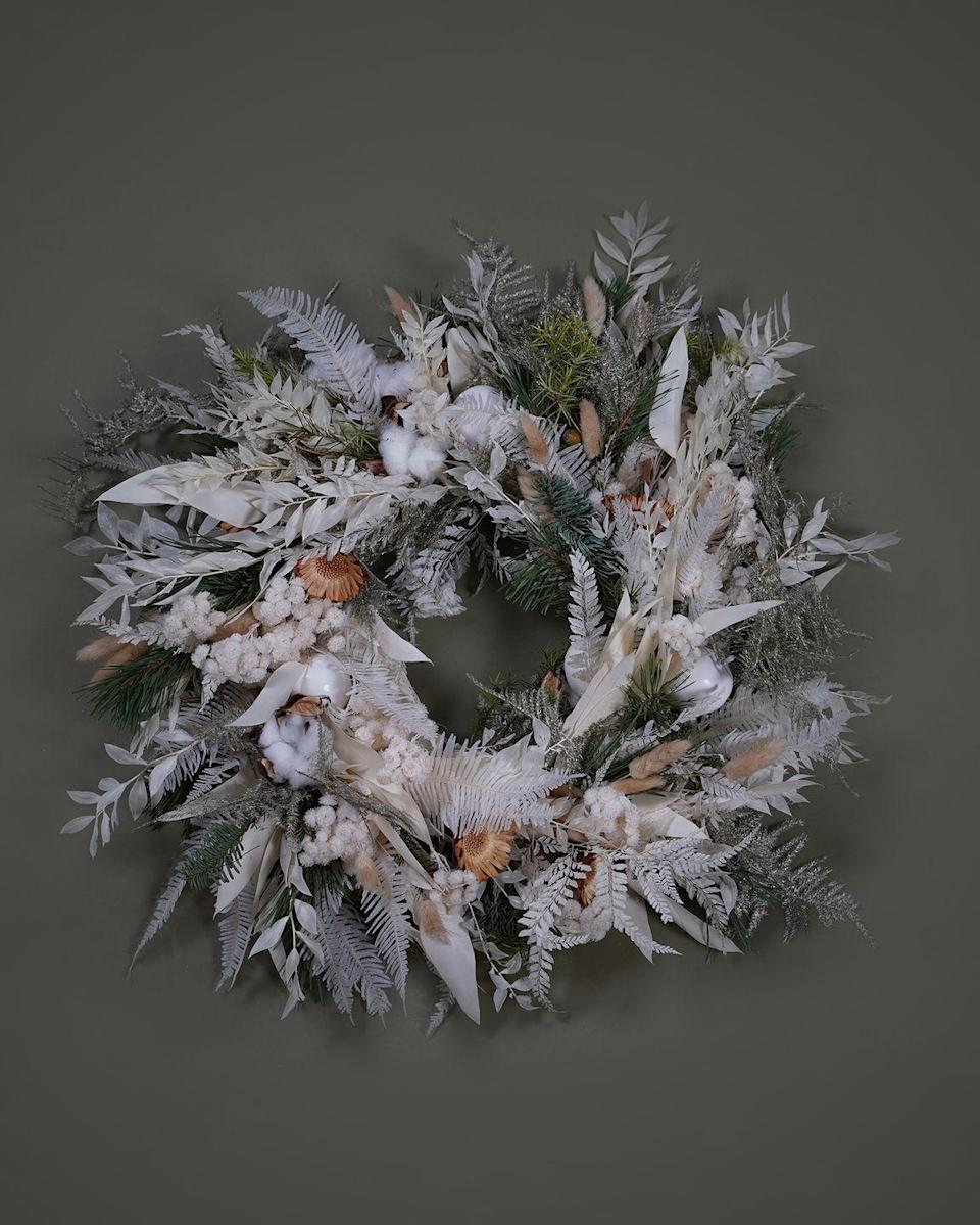 "<p>Dreaming of a white Christmas? Make it snow early with this ethereal fresh wreath from this renowned florists with flower schools in London, New York and Seoul. Asparagus fern, white ruscus and frosted wax apples give this design a Narnia-like appeal. £150, <a href=""https://mcqueens.co.uk/product/sn-wreath/"" rel=""nofollow noopener"" target=""_blank"" data-ylk=""slk:mcqueens.co.uk"" class=""link rapid-noclick-resp"">mcqueens.co.uk</a></p>"