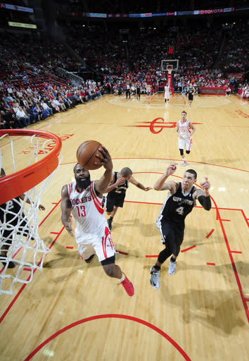 HOUSTON, TX - MARCH 24: James Harden #13 of the Houston Rockets shoots the ball against Danny Green #4 of the San Antonio Spurs on March 24, 2013 at the Toyota Center in Houston, Texas. (Photo by Bill Baptist/NBAE via Getty Images)