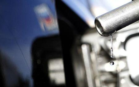 Gasoline drips off a nozzle during refueling at a gas station in Altadena