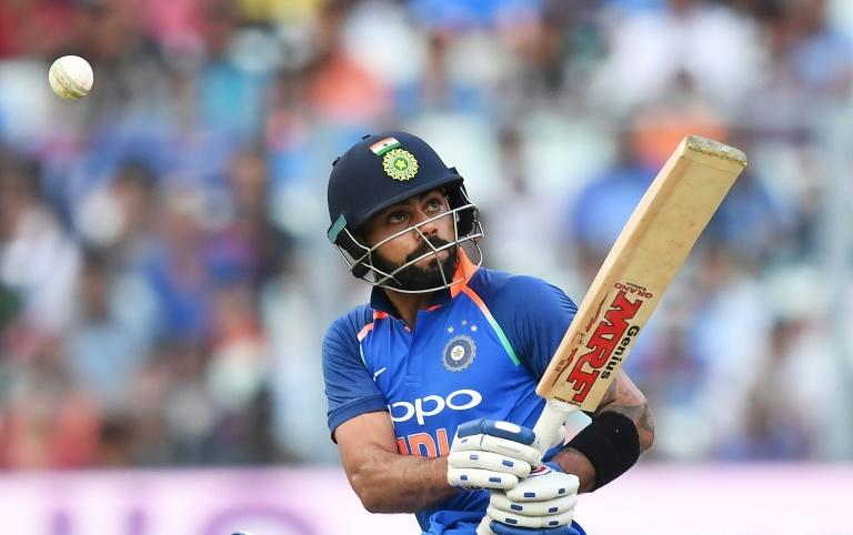India's captain Virat Kohli plays a shot during the second (ODI) match of the ongoing India-Australia series at the Eden Gardens stadium in Kolkata on September 21, 2017