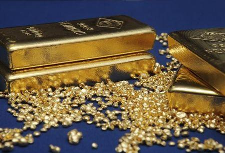 Gold bars and granules are pictured at the Austrian Gold and Silver Separating Plant 'Oegussa' in Vienna