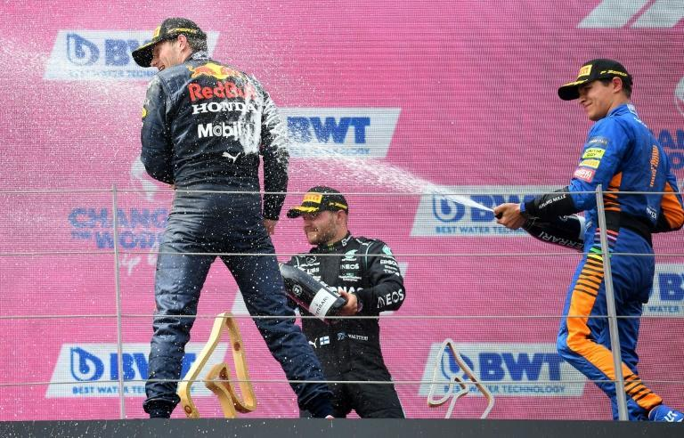 Norris (right) overcomes time penalty to make podium