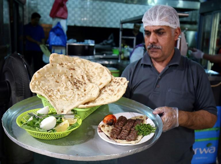 Iranian flat bread is offered alongside dishes popular in Kuwait (AFP Photo/Yasser Al-Zayyat)
