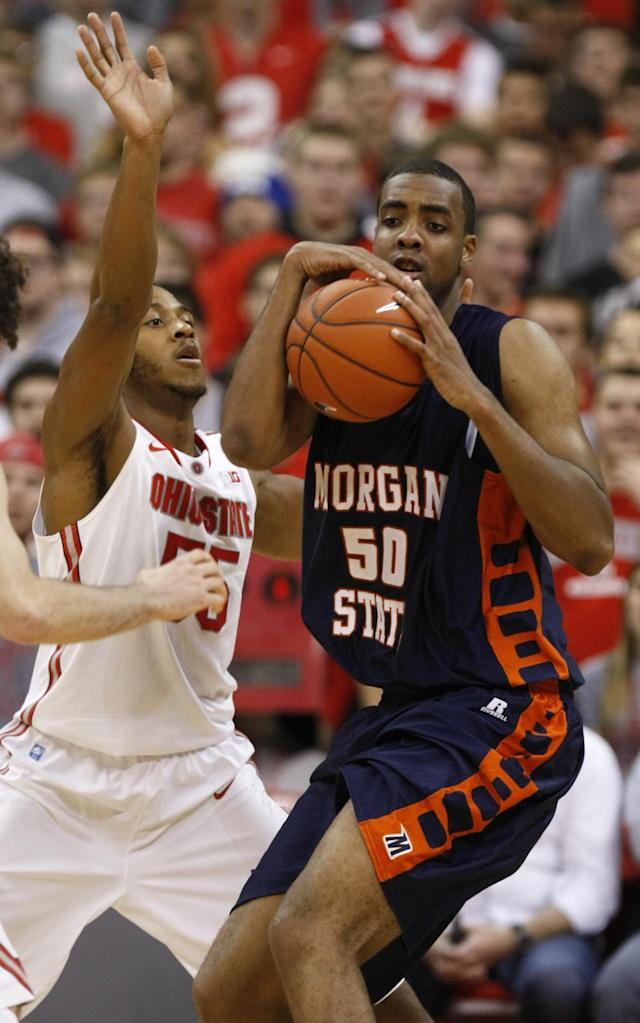 Morgan State's Ian Chiles, right, works for the ball against Ohio State's Trey McDonald during the second half of an NCAA college basketball game in Columbus, Ohio, Saturday, Nov. 9, 2013. Ohio State won 89-50. (AP Photo/Paul Vernon)