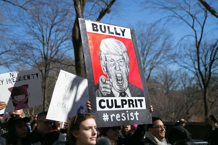 """<p>Demonstrator carry an anti-Trump sign during the """"Not My President's Day"""" rally at Central Park West in New York City on Feb. 20, 2017. (Gordon Donovan/Yahoo News) </p>"""