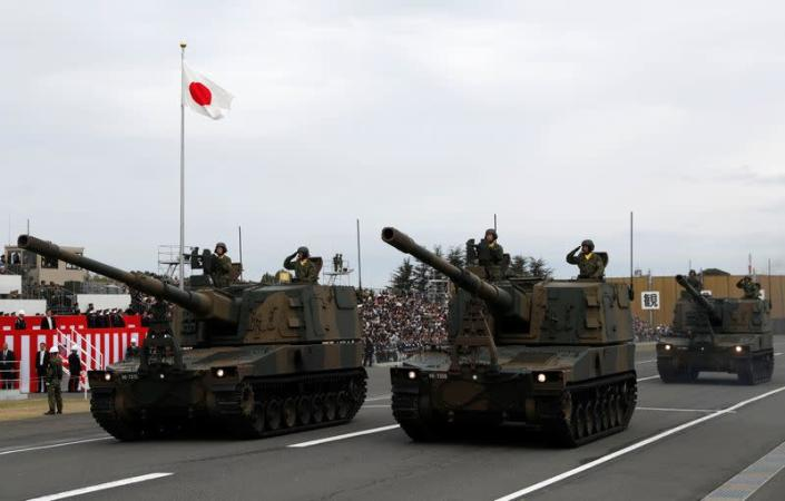 Japanese Self-Defence Forces' (SDF) tanks parade during the annual SDF ceremony at Asaka Base in Asaka