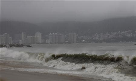 A view of a beach as waves move toward the shore during rainfall brought on by Hurricane Raymond, in Acapulco