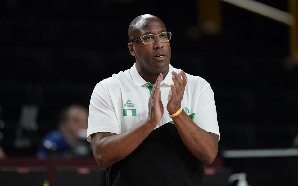 Nigeria's head coach Michael Brown reacts during men's basketball preliminary round game between Italy and Nigeria at the 2020 Summer Olympics, Saturday, July 31, 2021, in Saitama, Japan. (AP Photo/Charlie Neibergall)