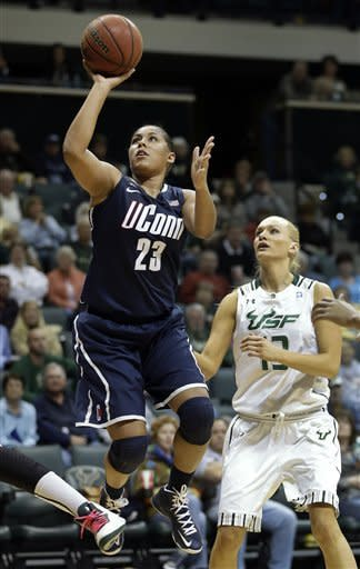 Connecticut forward Kaleena Mosqueda-Lewis (23) shoots past South Florida guard Inga Orekhova (13) during the second half of an NCAA college basketball game Saturday, March 2, 2013, in Tampa, Fla. Mosqueda-Lewis had 32 points in UConn's 85-51 win. (AP Photo/Chris O'Meara)