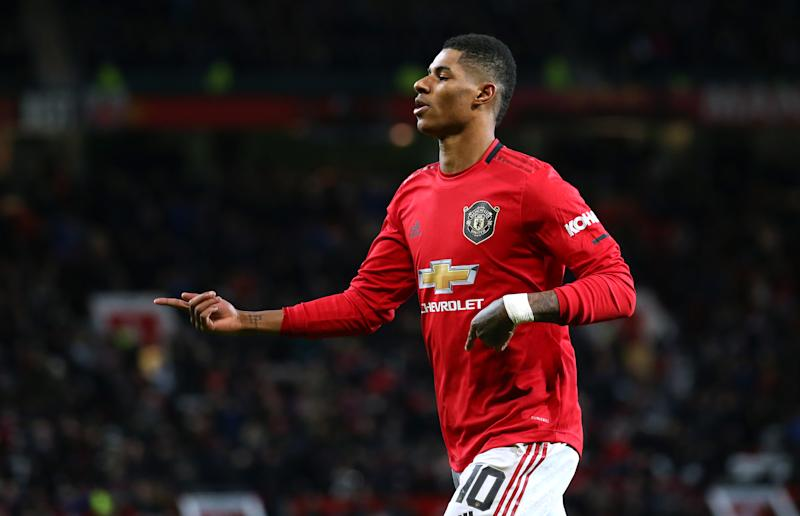 MANCHESTER, ENGLAND - DECEMBER 18: Marcus Rashford of Manchester United celebrates after scoring the opening goal during the Carabao Cup Quarter Final match between Manchester United and Colchester United at Old Trafford on December 18, 2019 in Manchester, England. (Photo by James Gill - Danehouse/Getty Images)