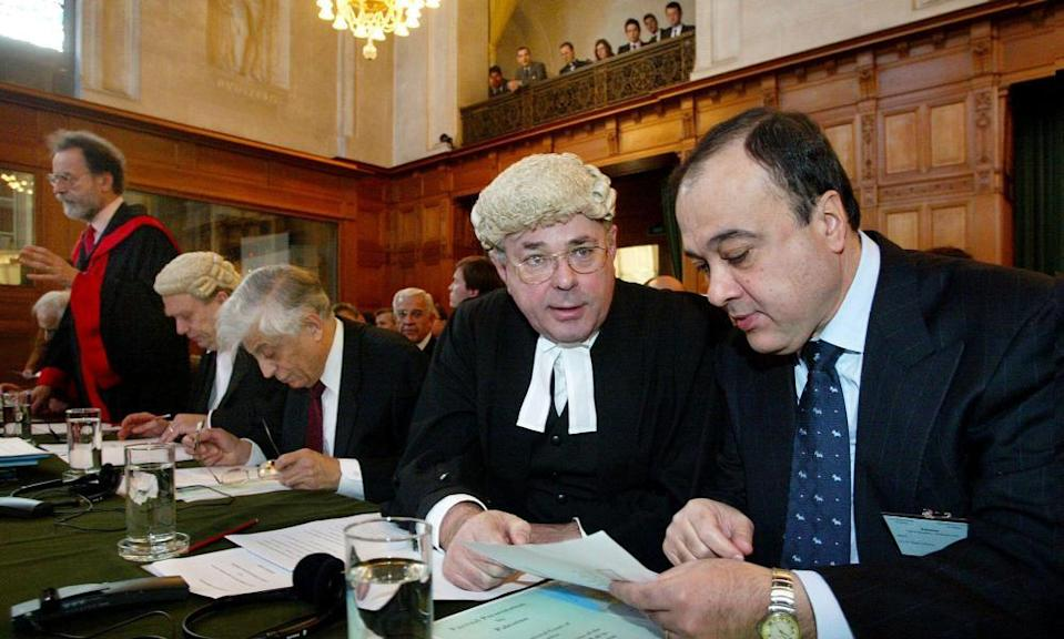 James Crawford, foreground left, talking to Nasser Al-Kidwa at the International Court of Justice in The Hague, Netherlands, 2004.