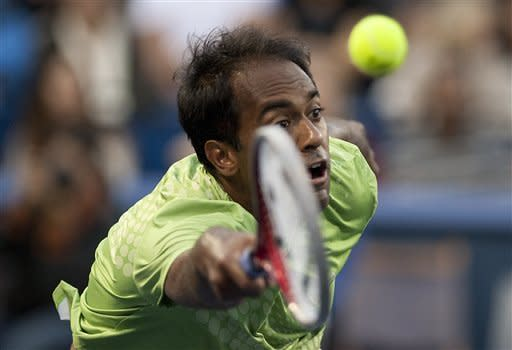 Rajeev Ram, of the United States, returns the ball during a semifinals singles match against Sam Querrey, of the United States, at the Farmers Classic tennis tournament, Saturday, July 28, 2012, in Los Angeles. Querrey defeated Ram in the first two sets and will move onto Sunday's finals. (AP Photo/Grant Hindsley)