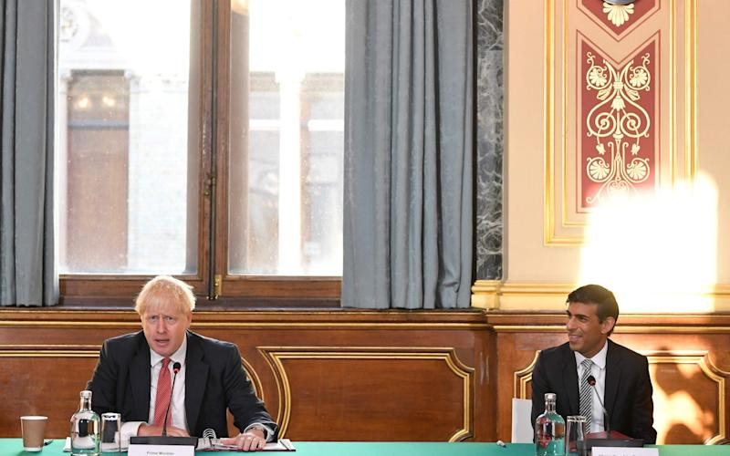 Britain's Chancellor of the Exchequer Rishi Sunak (R) looks on as Britain's Prime Minister Boris Johnson (L) speaks during a Cabinet meeting of senior government ministers at the Foreign and Commonwealth Office (FCO) in London on September 1, 2020 - Toby Melville/AFP