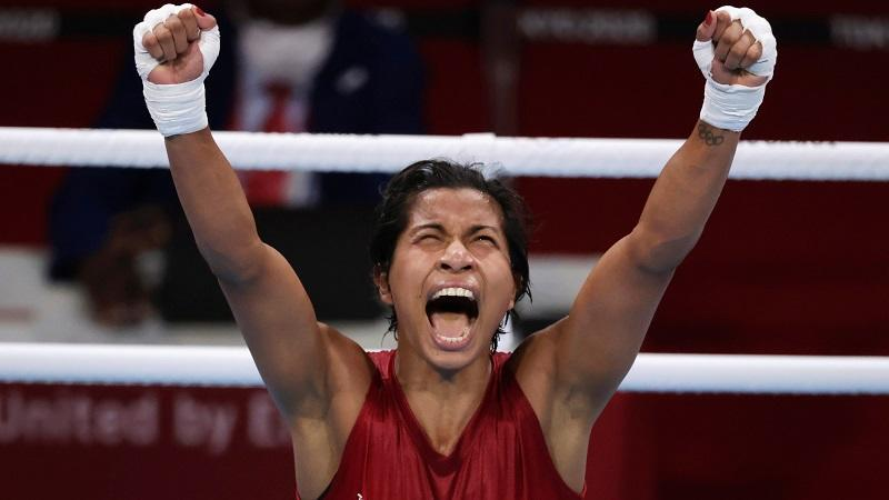 Lovlina Borgohain celebrates after the fight against Chen Nien-Chin. Image credit: REUTERS/Ueslei Marcelino