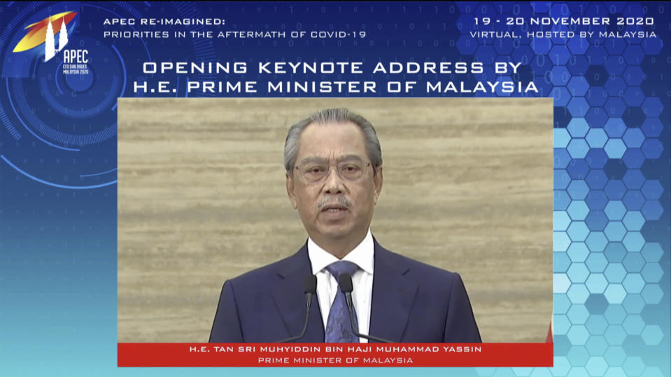 In this image from video released by APEC CEO Dialogues Malaysia 2020, Malaysia's Prime Minister Muhyiddin Yassin, speaks at a CEO Dialogue forum via video link, ahead of the Asia-Pacific Economic Cooperation (APEC) leaders' summit, hosted by Malaysia, in Kuala Lumpur, Malaysia, Thursday, Nov. 19, 2020. (APEC CEO Dialogues Malaysia 2020 via AP)
