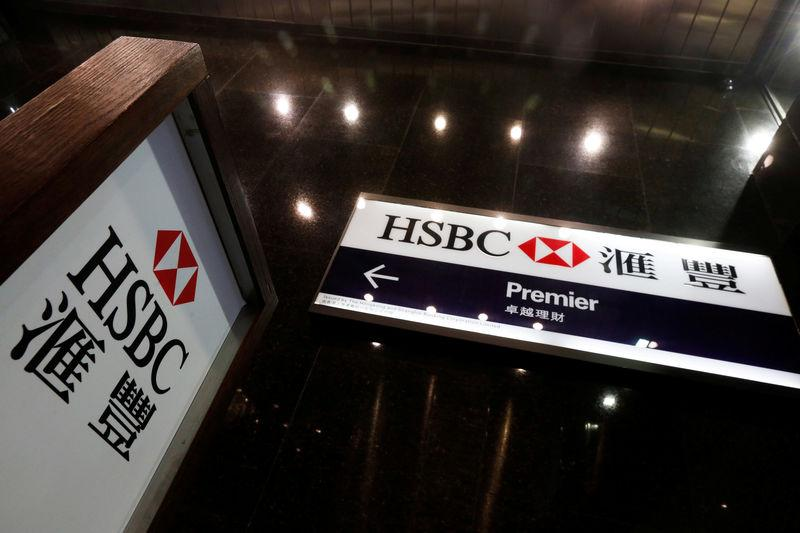 FILE PHOTO: Logos of HSBC are displayed at a major branch at the financial Central district in Hong Kong