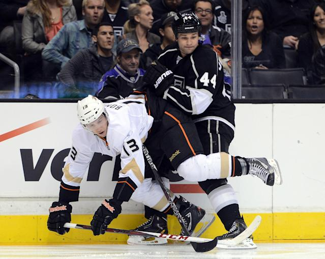 LOS ANGELES, CA - FEBRUARY 25: Davis Drewiske #44 of the Los Angeles Kings checks Nick Bonino #13 of the Anaheim Ducks to the ice during the second period at Staples Center on February 25, 2013 in Los Angeles, California. (Photo by Harry How/Getty Images)