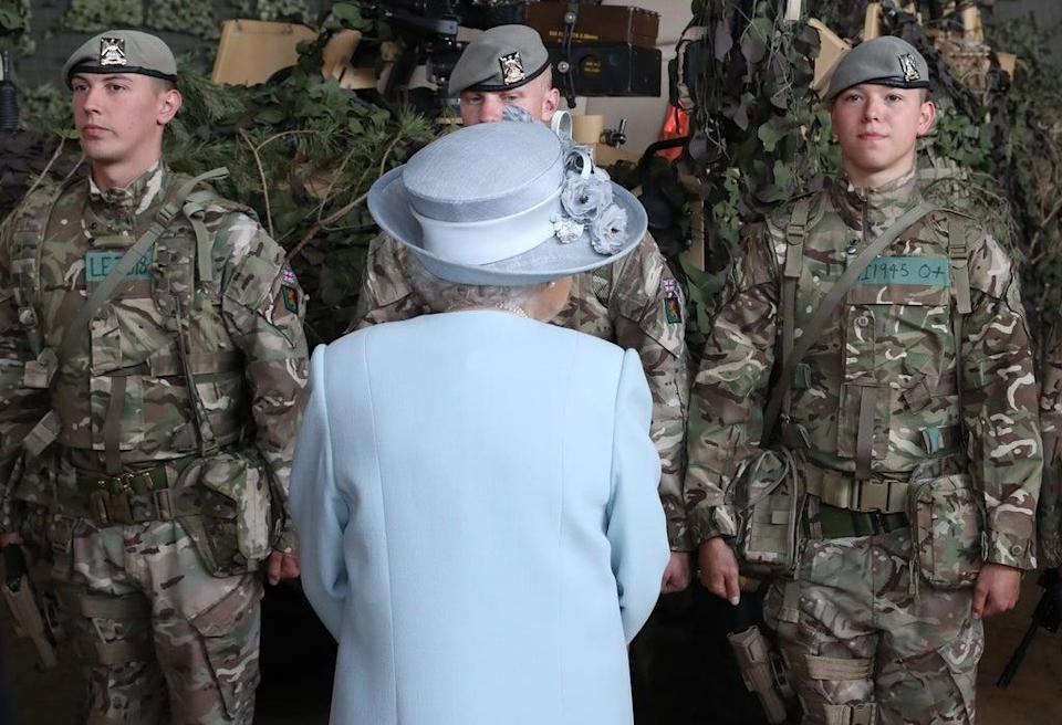 The Queen meets soldiers from the Royal Scots Dragoon Guards after presenting a new standard to the regiment at Leuchars Station in Fife (Andrew Milligan/PA) (PA Archive)