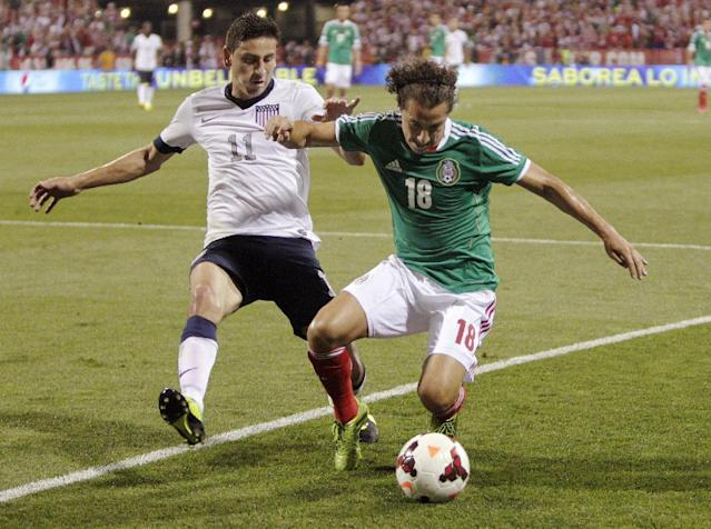 The United States' Alejandro Bedoya, left, and Mexico's Andrs Guardado chase a loose ball during the first half of a World Cup qualifying soccer match Tuesday, Sept. 10, 2013, in Columbus, Ohio. (AP Photo/Jay LaPrete)