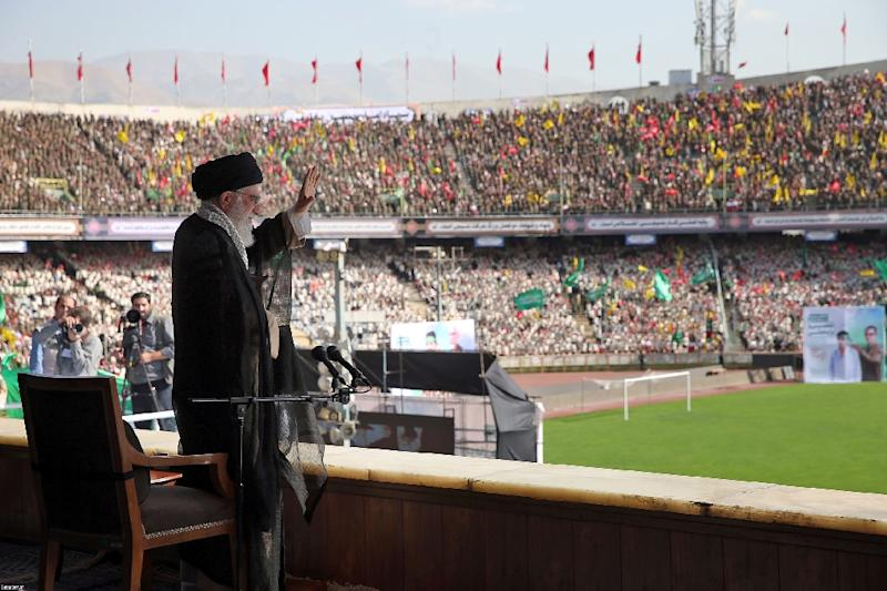 Iran's supreme leader Ayatollah Ali Khamenei waves to the crowd in an address to tens of thousands of voluntary forces (Basij) at Azadi Stadium in the Iranian capital Tehran