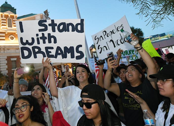 """Immigrants and supporters on Sept. 10 chant during a """"We Rise for the Dream"""" rally on the Las Vegas Strip to oppose President Trump's order to end DACA. (Photo by Ethan Miller/Getty Images)"""