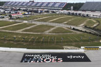 A sign thanking people working during the coronavirus pandemic is displayed in a turn at Darlington Raceway Sunday, May 17, 2020, in Darlington, S.C. NASCAR, which has been idle for 10 weeks because of the pandemic, makes its return with the Real Heroes 400 Nascar Cup Series auto race Sunday. (AP Photo/Jenna Fryer)