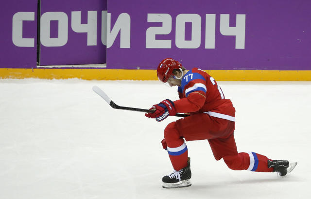 Russia defenseman Anton Belov reacts after scoring a goal against Slovenia in the third period of a men's ice hockey game at the 2014 Winter Olympics, Thursday, Feb. 13, 2014, in Sochi, Russia. (AP Photo/Mark Humphrey)