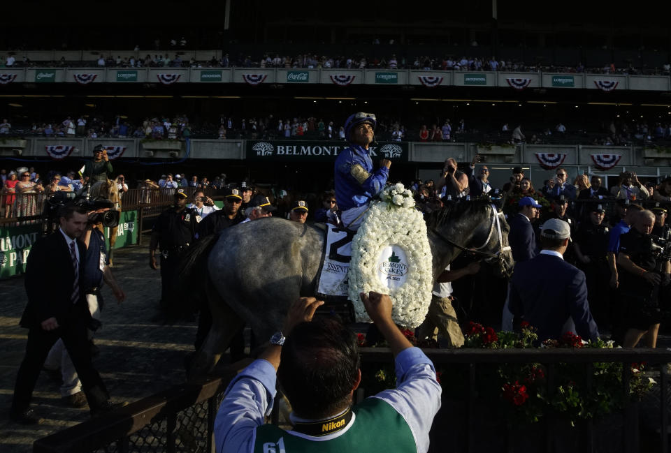 Essential Quality (2), with jockey Luis Saez up, walks to the winner's circle after winning the 153rd running of the Belmont Stakes horse race, Saturday, June 5, 2021, at Belmont Park in Elmont, N.Y. (AP Photo/Eduardo Munoz Alvarez)