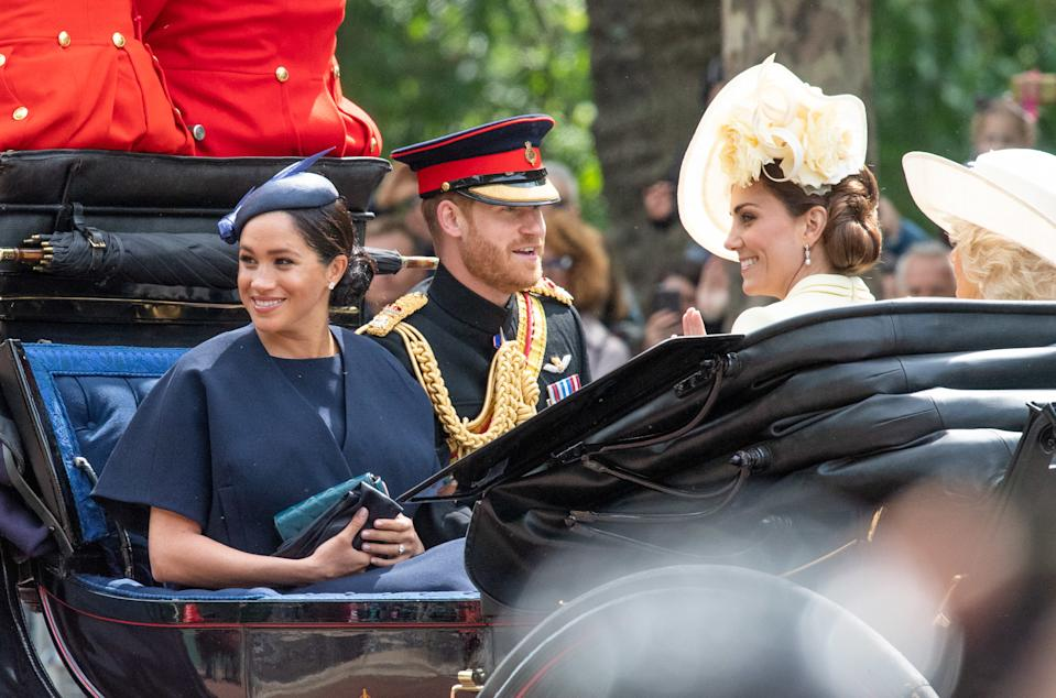 Meghan, Duchess of Sussex rides in an open carriage with Prince Harry, Duke of Sussex  and Catherine, Duchess of Cambridge during Trooping the Colour in London on June 08, 2019.  This was her first public engagement since the birth of her son Archie.