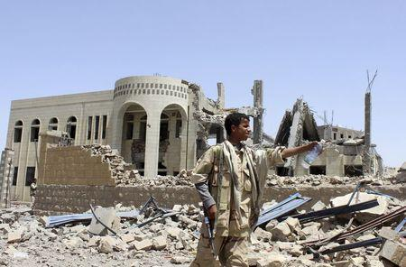 A Houthi militant stands in front of a court building, which was damaged in a Saudi-led air strike in Saada May 31, 2015. REUTERS/Stringer