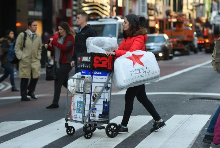A New York shopper takes advantage of the 2017 Black Friday sales, which kicked off the day after Thanksgiving